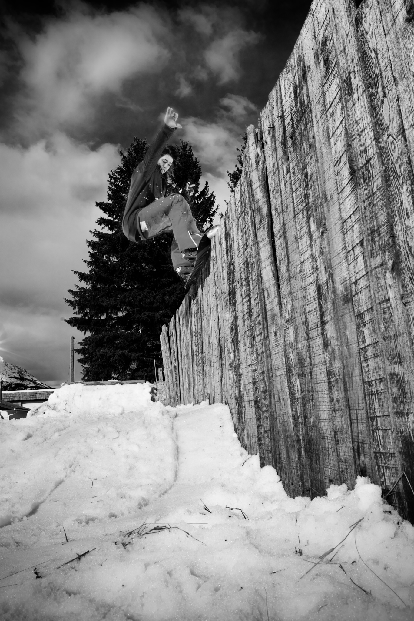 Chris Bradley, 50-50 on the neighbour's fence. Fernie B.C. Canada.